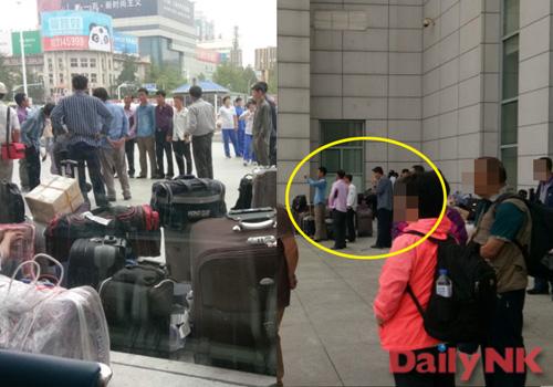Северокорейские рабочие на железнодорожной станции в Даньдуне, Китай.