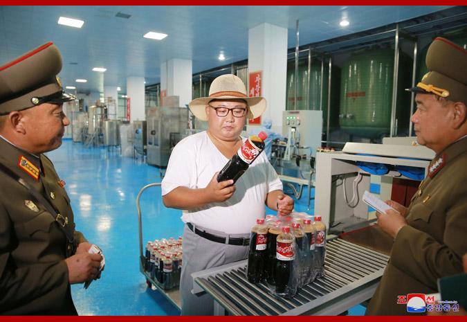 Ким Чен Ын на фабрике обработки засоленных рыбных продуктов 2